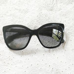 Chanel black cat eye quilted side sunglasses.